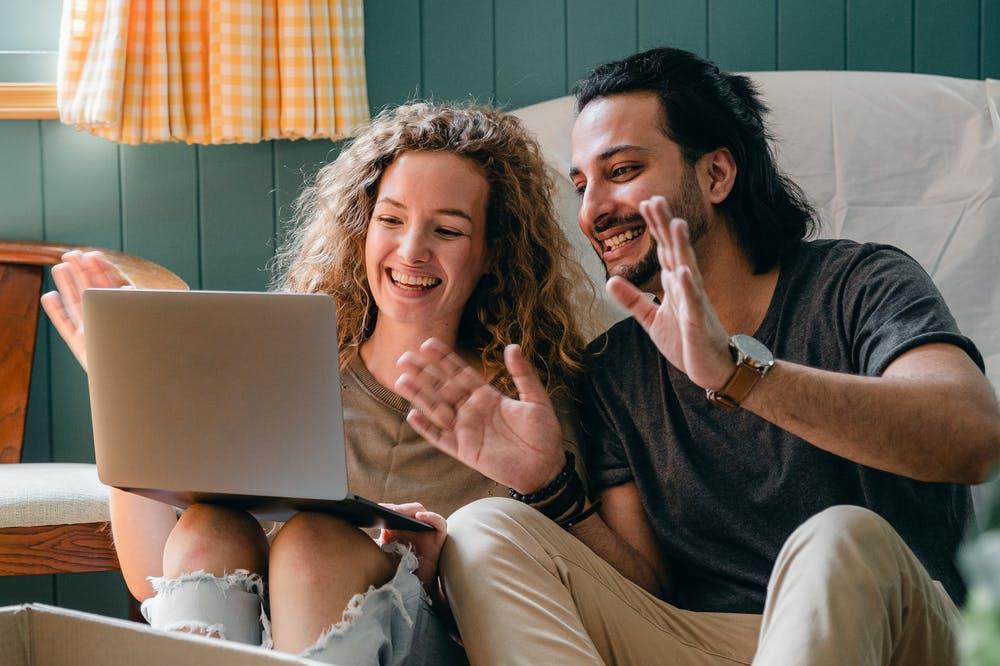Couple talks with broker on laptop